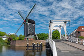 Bridge and windmill in Netherlands — Stock Photo