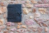 Stone wall and window — Stock Photo