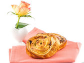 Golden brown baked pastry and flower for breakfast — Photo