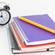 Photo: Notebooks and pencil isolated on white background