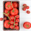 Stock Photo: Tomatoes with drops on basket