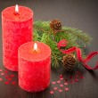 Christmas decoration: fir sprig,candles, cones — Stock Photo #33132827