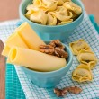 Bowl of tortellini homemade with cheese and walnuts — Stock Photo #33493555