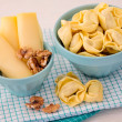 Bowl of tortellini homemade with cheese and walnuts  — Stock Photo