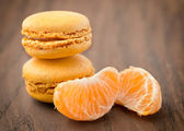Mandarin macaroons on wooden background — Stock Photo