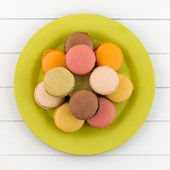 Colorful macaroons on a plate — Stock Photo