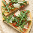 Two pieces of pizzwith arugula — Stock Photo #27208973