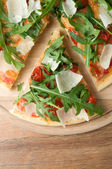 Pizza with arugula top view — Stock Photo