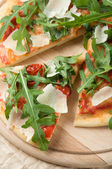 Pizza with arugula (rucola) — Stock Photo