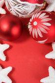 Xmas decoration on the red with copy space — Stockfoto