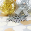 Beautiful xmas baubles on paper with hearts — Stock Photo