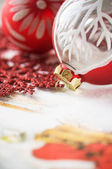 Red and white xmas baubles close up — Stock Photo
