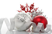 Red and silver xmas baubles — Stockfoto