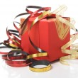 Red gift box with colorful ribbons on white background — Stock Photo