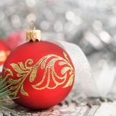 Red and silver xmas ornaments on bright holiday background — Stock Photo