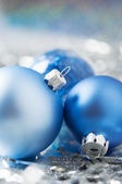 Blue and silver christmas decoration on holiday background — Stock Photo