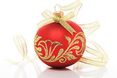 Red xmas ball and golden ribbon on the white — Stock Photo