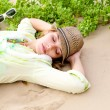 Gilr lying on beach — Stock Photo