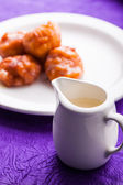 Cream and fritters — Stock Photo