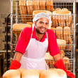 Baker and his bread — Stock Photo