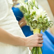 Women standing with flowers — Stockfoto