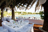 Tables by the waters edge — Stockfoto
