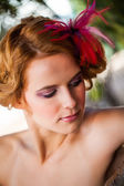 Feathers in the hair — Stock Photo