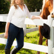 Goldilocks at the fence — Stock Photo