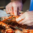 Stock Photo: King prawns and oily fingers