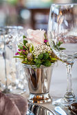 Crystal, silver and wild flowers — Stock Photo
