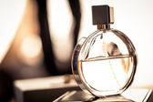 Bottle of womans fragrance — Stock Photo