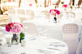 Flowered centerpieces on multiple settings — Stock Photo