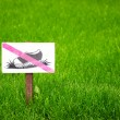 Stock Photo: Don t step on grass sign.