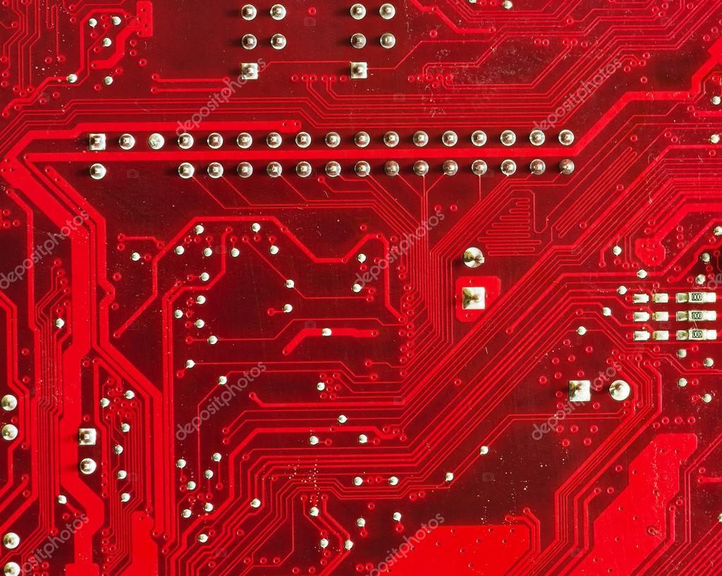 印制的红色电脑电路板的特写–