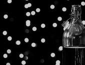 Bokeh Lights behind bottle — Stock Photo