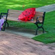 Stock Photo: Park bench in summer time