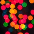 Multi color Christmas light bokeh background — Stock Photo