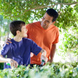 Father and son doing yard work together. — Stock Photo