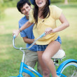 Young massisting young womon bike — Stock Photo #25952653
