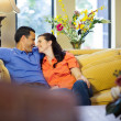 Man and woman sitting on couch. — Stock Photo #25953977