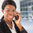 Stock Photo: African-AmericWomon cell phone