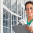 Female doctor with clipboard — Stock Photo #25954883