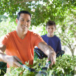 Father and son doing yard work. — Stock Photo #25955053