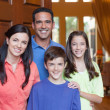 Stock Photo: Family standing in entryway of home