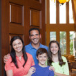 Family standing in entryway of home — Stock Photo