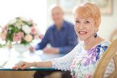 Happy Senior Couple in Diningroom — Stock Photo