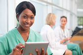 Smiling nurse with two doctors — Stock Photo