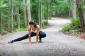 Middle aged woman stretching — Foto Stock