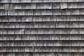Weathered side of old home — Stock Photo