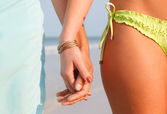 Young Couple Holding Hands on the Beach — Stock Photo